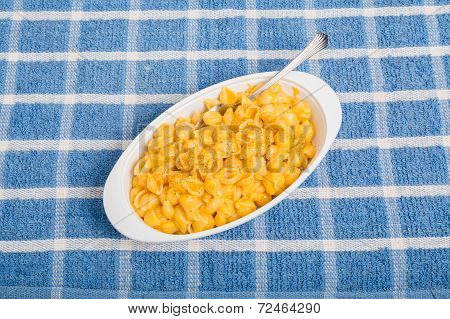 Macaroni And Cheese With Fork On Blue Placemat
