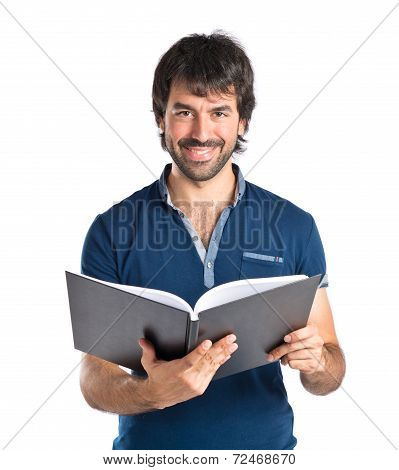 Man Reading A Book Over White Background