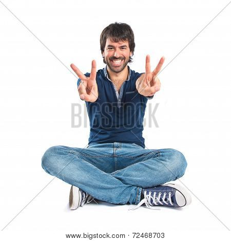 Man With Thumb Up Over White Background