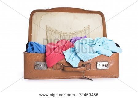 old brown suitcase full with clothes isolated before white background