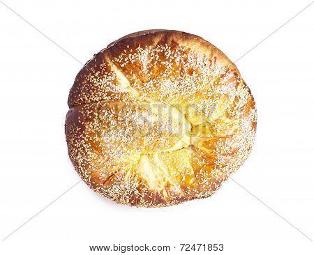 Sweet spiral brioche bread with sesame seeds center closeup