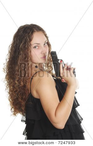 Serious Woman With Gun Looking Over Shoulder