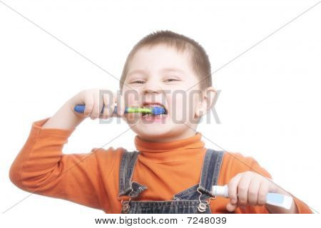 Boy With Toothpaste And Brush