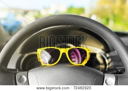Yellow Glasses On The Wheel.
