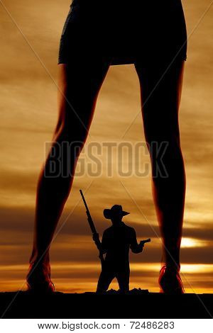 Silhouette Of Woman  In Dress And Heels Legs Cowboy