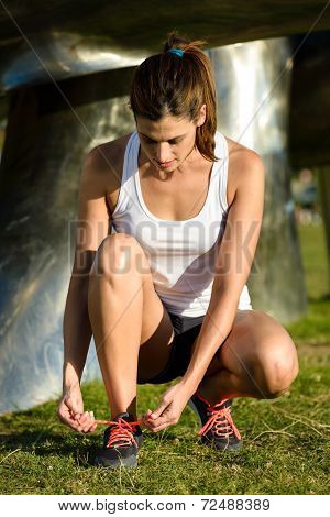 Female Runner Lacing Sport Shoes Before Running