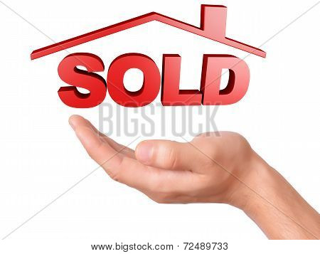 hand holding sold house isolated on white background