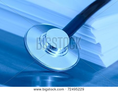 Stethoscope And A Stack Of Paper. The Concept Of Medical Legislation