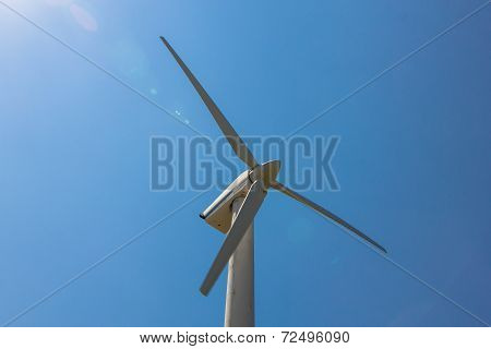 Wind Turbine Over The Blue Sky