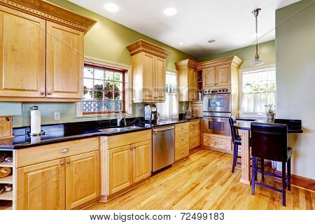 Light Tones Kitchen Cabinets And Small Table With Chairs