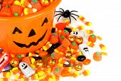 foto of jack-o-lantern  - Halloween Jack o Lantern pail overhead view with pile of candy - JPG
