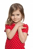 picture of shy girl  - A closeup portrait of a shy preschool girl on the white background - JPG