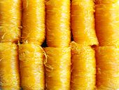 picture of thong  - close up gold egg yolks thread dessert  call foi thong in Thailand