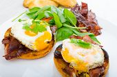 foto of benediction  - Eggs benedict with bacon and spinach on white plate - JPG