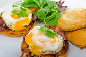 image of benediction  - Eggs benedict with bacon and spinach on white plate - JPG