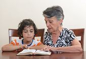 foto of holy family  - Grandmother teaching the Holy Bible to her grandson - JPG