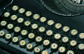 picture of verbs  - keys of a worn vintage typewriter - JPG