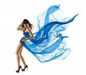 stock photo of flutter  - Woman Sexy Dancing in Blue Dress - JPG
