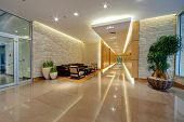 stock photo of modern building  - Corridor inside of modern building with wooden panels on walls - JPG