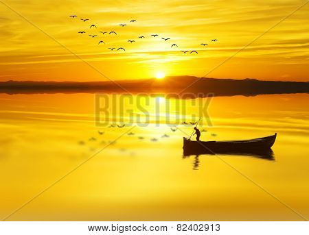 a fishmonger in his traditional boat at sunrise