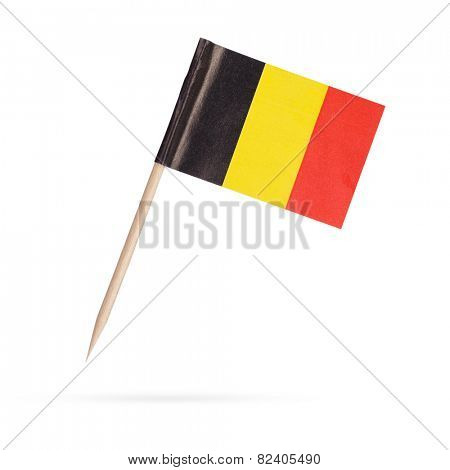 Miniature paper flag Belgium. Isolated on white background. With shadow below