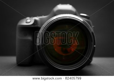 Digital camera on dark background