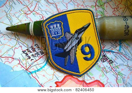 Illustrative editorial.Chevron of Ukrainian air force. 9 Aviation brigade.Estern Ukraine map with site MH-17 flight crush and 30 mm cannonshell for air cannon. At January 10,2015 in Kiev, Ukraine