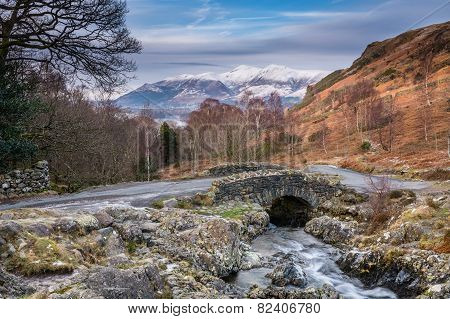 Ashness Bridge And Snow Capped Skiddaw