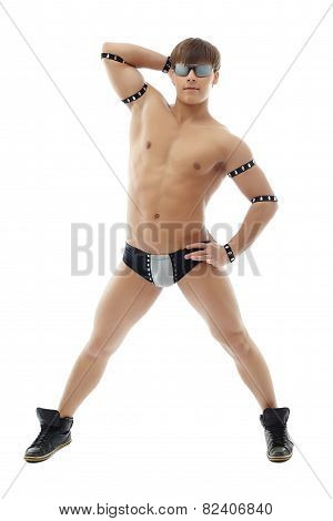 Smug male dancer posing at camera