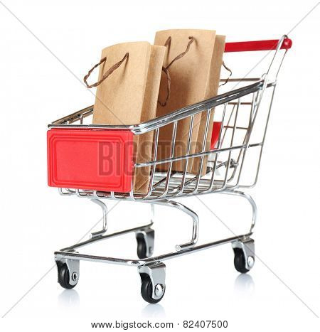 Small shopping cart with paper bags isolated on white