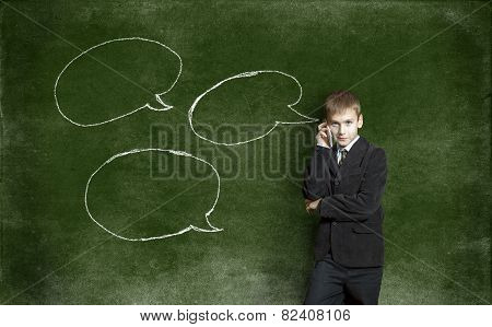 The Boy On Telephone Amid The Drawing With Chalk On The Blackboard