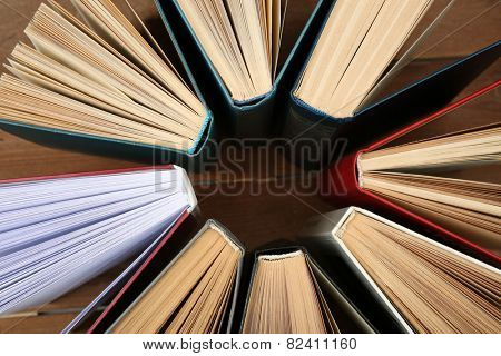 Group of books on wooden planks background, top view