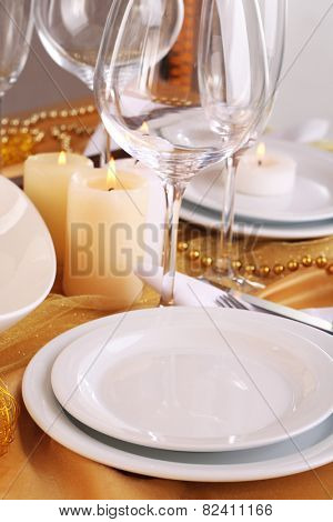 Beautiful holiday table setting in white and gold color