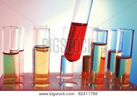 Test tube filled with red liquid on background of other tubes, close-up