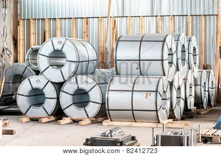 Bended Metal Sheet Rolls In Factory Warehouse. Metal Engineering.