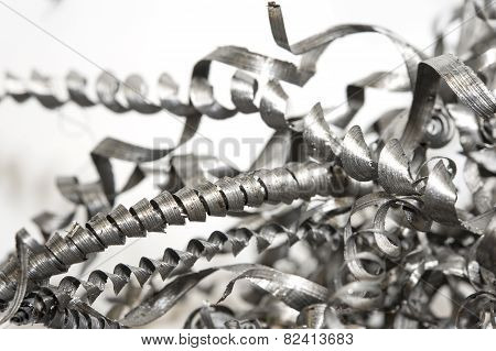 Closeup Twisted Spiral Steel Shavings. Drilling Industry