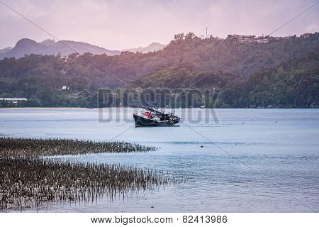 Old Fishing Boat Near A Coast Ot Tropical Island