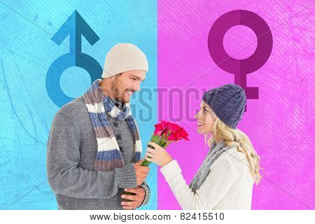Attractive man in winter fashion offering roses to girlfriend against female gender symbol