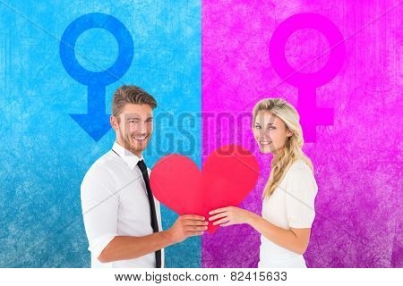 Attractive young couple holding red heart against female gender symbol