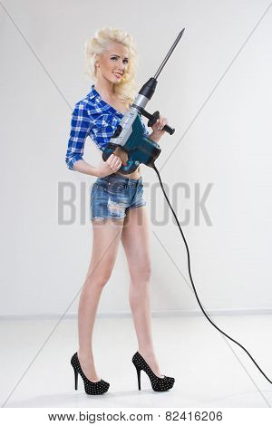 blonde with industrial hammer. light background