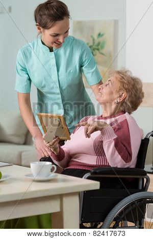 Nurse Caring About Handicapped Woman
