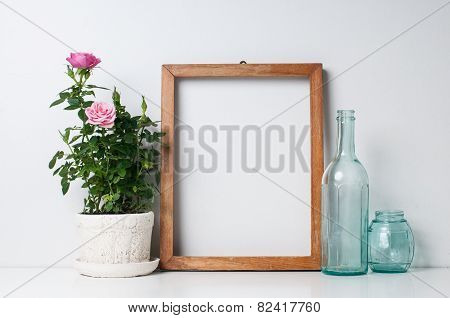 Frame, Bottles And Rose