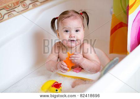 Cute baby  taking a bath