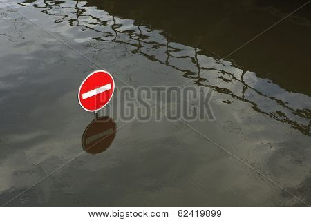 USTI NAD LABEM, CZECH REPUBLIC - JUNE 5, 2013: No entry for vehicles, a traffic sign flooded by the swollen Elbe River in Usti nad Labem, Northern Bohemia, Czech Republic, on June 5, 2013.
