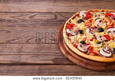 Pizza with seafood on wood table