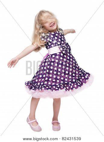 Beautiful Little Girl Spinning Around Isolated
