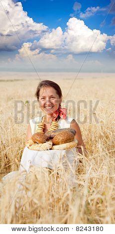 Eldery Woman  With Bread