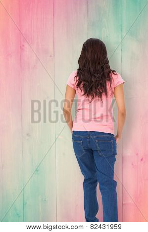 Pretty brunette stepping against pink and green planks