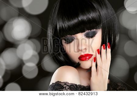 Beautiful Glamour Girl with Smoky Eyes and Red Nails