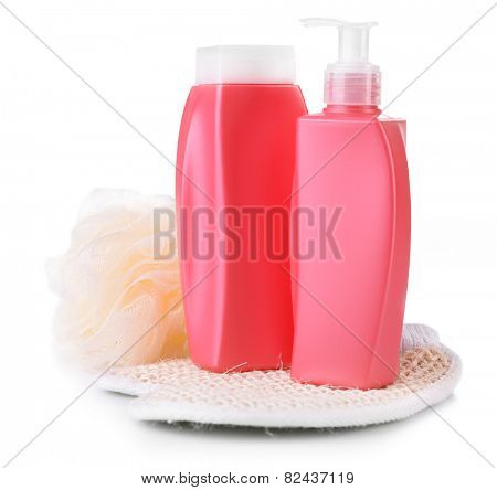 Shampoo and shower gel with wisp isolated on white